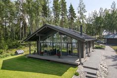 The stylish Sirius features a front elevation made entirely of glass. Prefab Homes, Log Homes, House In The Woods, My House, South African Homes, Log Home Kits, Modern Modular Homes, Lodge Style, Lake Cabins
