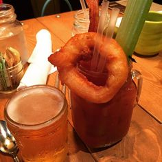 Downtown Campbell: Bloody Mary with an onion ring & bacon garnish??? And a shorty beer chaser??? Love! #bloodymary #cheflife #familytime by chefalihouston