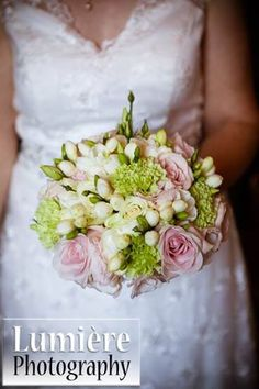 pink roses, pink lissianthus, freesia, green carnations