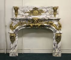 Very Important Late 19th Century Gilt Bronze Mounted Palatial Fireplace Surround  This fireplace is an exact copy of the original 18th Cent...