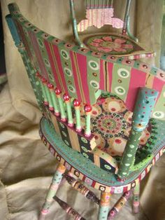 I can see myself finding some old chairs and painting each of them a different way and then using them in my kitchen :)