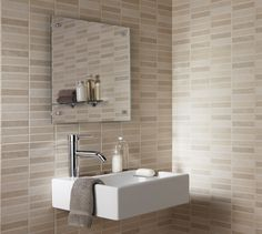 Malvern by Laura Ashley.  The natural stone look of the Malvern collection, from the Laura Ashley design studio provides a warm, sophisticated setting to any bathroom. The plain wall tile with its soft satin finish carries a gentle vein reminiscent of Cotswold stone and has a coordinating rectangular mixed tonal mosaic effect feature tile.