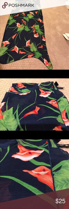 Beautiful Beach Wrap Dark blue and Coral. Flower Design. Beach Wrap. Can be used multiple ways. Size L/XL... size does not mean a smaller individual could not use as dress wrap for the beach.... would work for some S/M too depending how they wear it. GREAT CONDITION. NEVER USED JUST STORED. Swim Sarongs