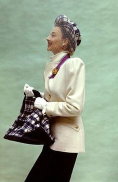 Dorian Leigh in white a gabardine jacket, plaid hat with a mesh veil, and matching bag, 1947. Ph. John Rawlings.