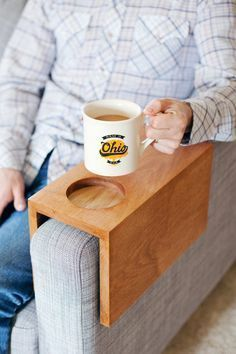 Sofa Hack: Wooden Armrest Table with Built-In Cup Holder - the hole is a nice touch.