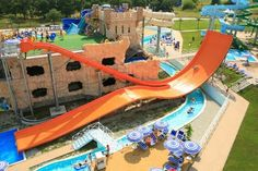 Catch some serious air on this wild water slide that splits in two for a unique twist on the traditional!