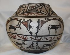 """Native American Historic Zuni Pottery Storage Jar 321. Native American, historic Zuni pottery Storage Jar. 11"""" tall, 14"""" diameter. Poly chrome designs with heart-line deer surrounded by solid and hatc"""
