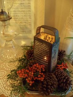 Rustic Christmas...vintage grater with candle and berries. #indoorchristmasdecor