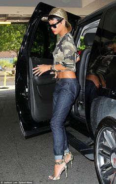Covered up again: The chart-topper was stepped out in a camouflage top and rolled up jeans, with a hint of toned tummy on display