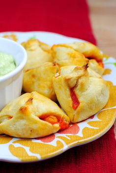 Buffalo Chicken Poppers with Avocado Bleu Cheese Dip ~ combine a spicy, creamy filling stuffed inside buttery crescent rolls with a cooling avocado bleu cheese dip.
