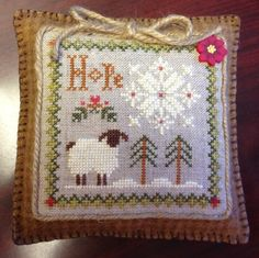 Petra's Hope Pillow (Little Sheep Virtues series), stitched with Dragonflylotus Designs' handspun wool thread pack
