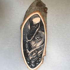 Wood slice with an original drawing of an owl