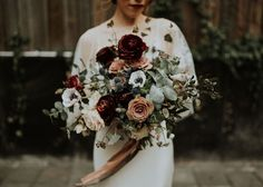"""Really love this bouquet, but would like something a little smaller, less greenery and more white/pale pink [less """"goth""""]. Also, no dangling ribbons [wrapped in white]."""