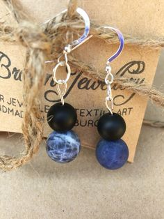 A personal favourite from my Etsy shop https://www.etsy.com/uk/listing/385515024/gemstone-drop-earrings-black-lava