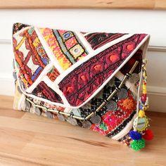 NAGAR by NAWERI 119€ Boho clutch made from antique embroidered fabrics with a removable strap. Pochette confectionnée à partir de tissus brodés antiques. Chaîne amovible. Modèle unique.