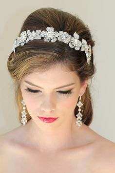 Featuring countless Swarovski Crystals individually encrusted into a delightfully sophisticated and intricate design, this regal and romantic head band adds opulence and ornate elegance to your bridal