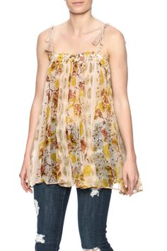 Sheer floraltop with adjustable tie spaghetti straps and tassel detail.   Flower Pattern Tunic by Free People. Clothing - Tops - Casual Clothing - Tops - Sleeveless Texas