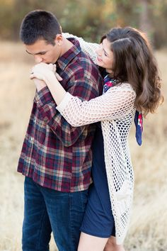 Engagement Portrait Arms Around From Behind Kissing Hand | Chico-California-Engagement-Wedding-Photographer-Bidwell-Park-Engagement-Photography