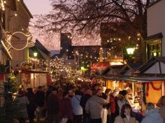 The wonderful Rheingau district winemaking town of Rüdesheim am Rhein - the long linear Christmas Market and shopping area winds around and down the hillside overlooking the Rhine river in Germany.