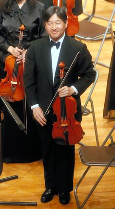 asahi:  Crown Prince Naruhito of Japan, shown here with his viola, and daughter Princess Aiko, performed with the All Gakushuin University Orchestra at Gakushuin University, Tokyo, April 13, 2014