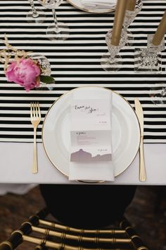 black and white stripe and gold wedding table setting