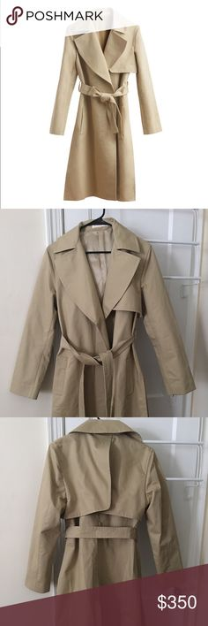 Cuyana Classic Trench coat NWOT/never worn. Really lovely but the color doesn't quite work for me. Comes with Cuyana garment bag. A timeless revision of a military staple, our Classic Trench is the epitome of Made in Italy. It reveals elements that are the essence of heritage, rendered in water-resistant Italian cotton-gabardine with storm flaps and snap-closure side splits. Considered details like a push stud at the back and the gold bars on the belt are a reflection of the custom hardware…