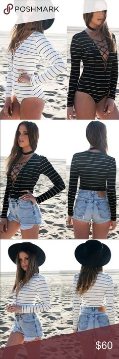 Stripe Lace Up Bodysuits Lace up striped bodysuits. 100% polyester. Unlined.  -- no trades -- -- firm price -- Lilacs & Lace Pants Jumpsuits & Rompers