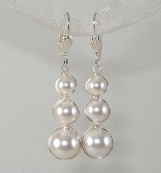 Swarovski Pearl Wire Wrapped Graduated Earrings. $24.00, via Etsy.