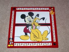 Mickey Mouse and Pluto framed art.