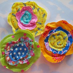 Would be super cute on a babg headband :) funky flowers..I LOVE Fabric Posies!!
