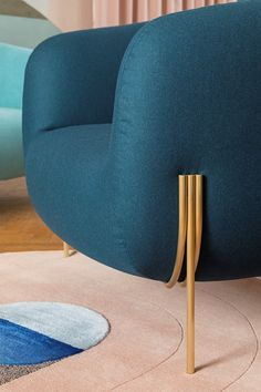 Armchair with removable cover with armrests GEO | Armchair by Saba Italia