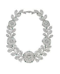 A BELLE EPOQUE DIAMOND AND EMERALD 'EGLANTINE' NECKLACE, BY CARTIER - Designed as a graduated dog rose garland, the five flowerheads with pavé-set diamond petals, old-cut diamond collet stamens and emerald detail, linked by pavé-set diamond twigs and leaves, enhanced by emerald berries, mounted in platinum and gold, 1906