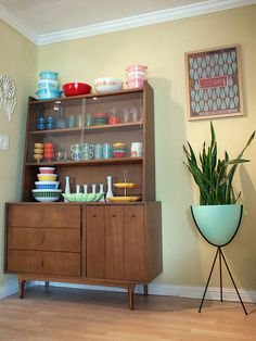 Mid century display cabinet. Vintage Pyrex. Mid century bullet planter.