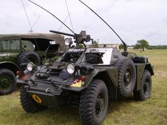 Side view of the Ferret, offering a better view of its spare tire, various communications antennae, and the pintle-mounted 7.62mm machinegun.