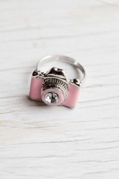 Pink Camera Ring. I LOVE THIS. I wish I could get everyone in the yearbook one of these for the end of the year gift