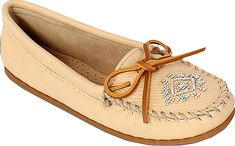 Minnetonka Women's Shoes in Champagne Color. This classic moccasin offers an updated luxurious look you're sure to love. Soft genuine deerskin upper with rawhide lace and decorative beading. Fully padded insole. Handmade using stitch and turn construction for maximum flexibility. Flexible rubber outsole #Minnetonka #champagne #shoes #fashion #style