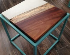 Concrete Wood and Steel End Table by BetonDesigns on Etsy. This end table is a fresh take on a classic design. We joined clean, white concrete with live edge rosewood for the top and set it inside a powder coated steel base.