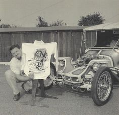 ed roth with his art and a crazy cool car creation