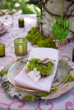love the table setting using moss and bark