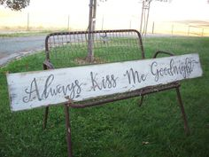 Rustic wood sign painted in antique white with the words always kiss me goodnight, painted in grey. This awesomely large rustic wood sign has been sealed with a clear matte finish. Its measurements are approx. 54 X 7 1/2 and I have attached two saw tooth hangers for wall mounting...but it also looks great leaning on a shelf or mantle.  A perfect gift for your Sweetheart!!  Since all my signs are hand painted, (no vinyl) the sign you receive will be slightly different than the one pictured…