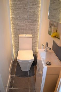 Strip lighting built into trim, thin sink