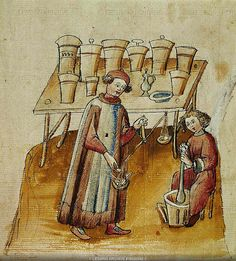 Cerruti family (14th century)-'a pharmacist and his assistant pound herbs and roots for medical use'-miniature   Wien-Österreichische Nationalbibliothek (Tacuinum Sanitatis, Codex 2644)