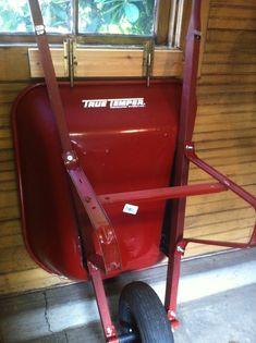 28 Brilliant Garage Organization Ideas | Sliding lock wheelbarrow storage