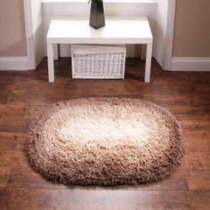 Think Rugs Shadow Oval Rug The Shadow is a machine washable shaggy rug in a circular shape with graduated brown to beige colours. Curtain Fabric, Curtains, Oval Rugs, Rugs Online, Eclectic Decor, Brown Beige, Beige Color, Color Patterns, Ottoman