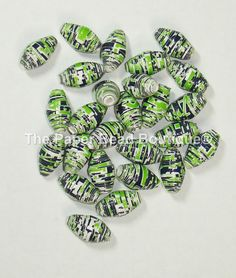 This ad is for a lot of 25 loose paper beads handmade by me! Ive used a high quality scrapbook cardstock in a beautiful Seahawks words design! They measure 3/4 wide and have been rolled on a 1/8 rolling tool. All of my beads are hand cut, hand rolled and then sealed, one by one, to protect the paper and give them that glossy shine! Perfect for any craft or jewelry project you might have planned!  Make your own Seahawks 12 Bling this year! Please contact me with further questions and thank…
