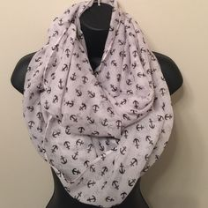White Anchor Away Infiniti Scarf White Infiniti Scarf feature Black Anchor detail , Light weight and adorable on.  100% Viscose Accessories Scarves & Wraps