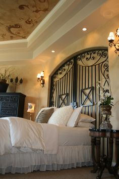 Iron gate headboard custom- made to fit in the niche. Love the ceiling!!!