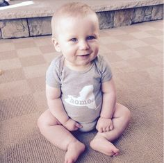 Baby onesies featuring your home state--or country. This company has such a great story.