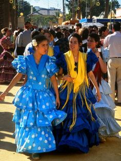 Women in traditional flamenco-style dresses