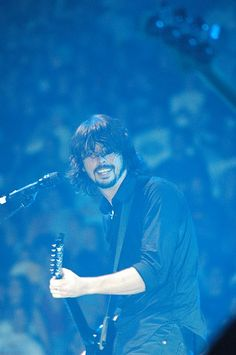 Dave Grohl  blue light haze playing guitar